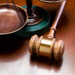 Gavel and Scales of Justice on wood table